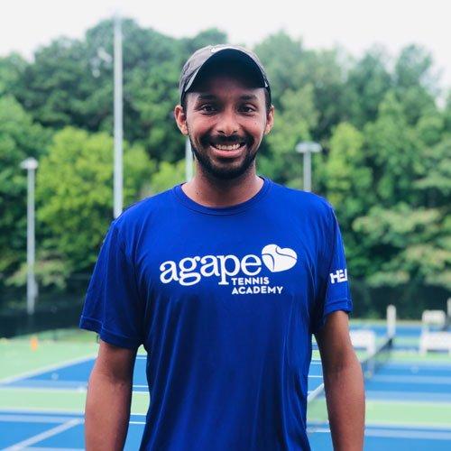 Coach Carloz Anez at Agape Tennis Academy