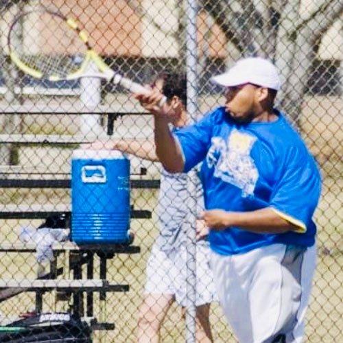 Coach Geoffrey Turner at Agape Tennis Academy